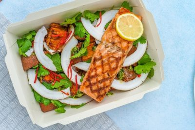 Tasty salmon on a bed of salad ready for take-away